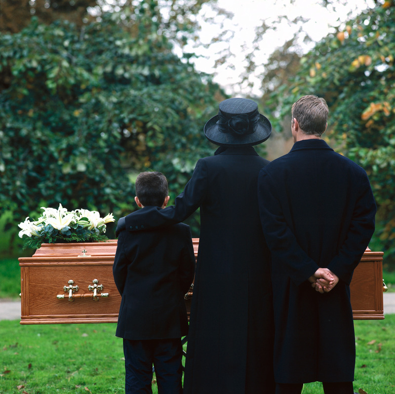 Family members at the funeral of a relative who was taken away by a wrongful death