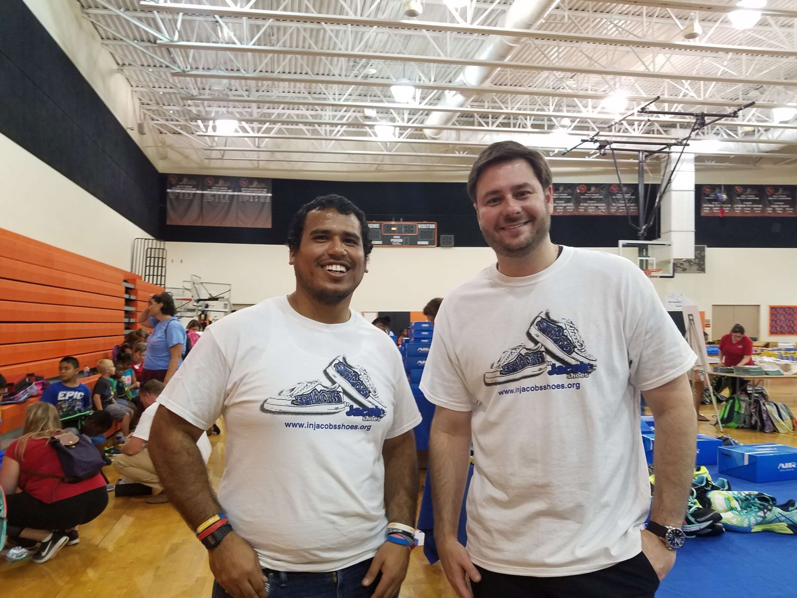 Adam and Walter pose for a photo at an In Jacob's Shoes community event