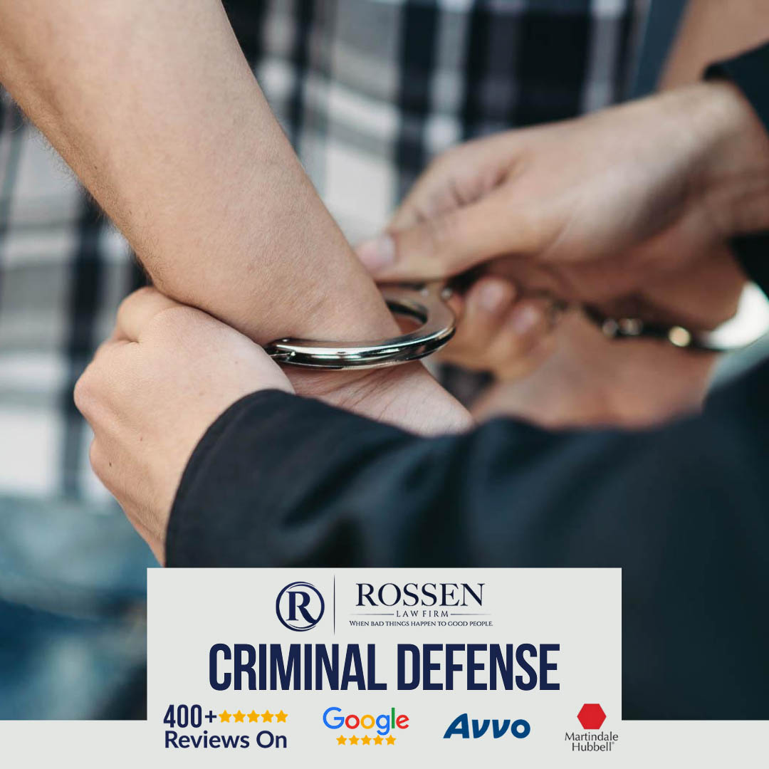 a police officer arrests a man and puts him in handcuffs in Fort Lauderdale. A criminal defense attorney with five-star reviews can help defend your rights