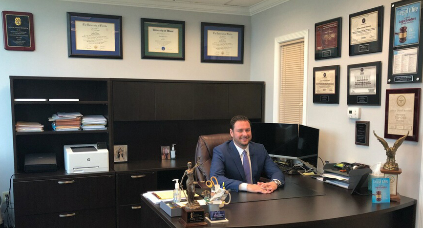 Criminal Defense Lawyer Adam sits in his Fort Lauderdale office