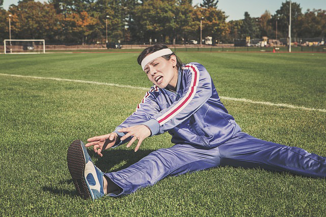 a woman is in a jogger outfit stretching on a soccer field in broward county. The article is about DUI field sobriety exercises in South Florida.