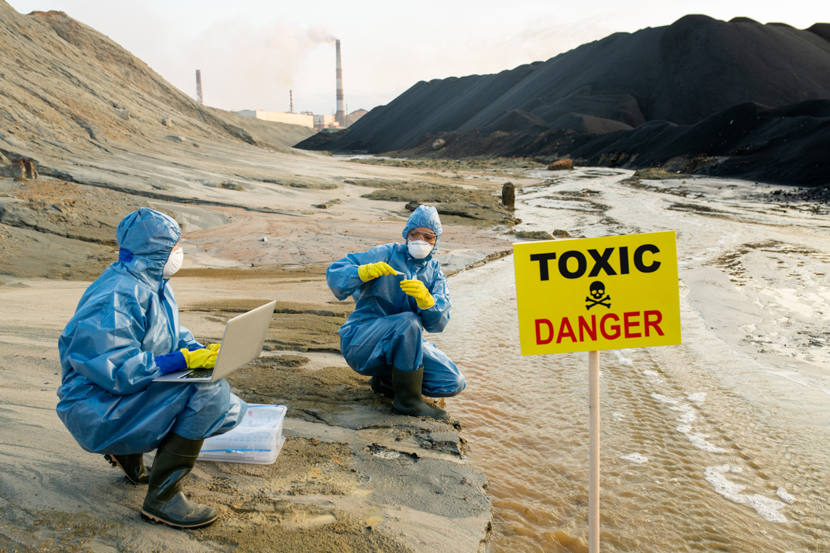 Federal agents are studying toxic waste dumped in Florida on this image. They're wearing blue hazmat suits and