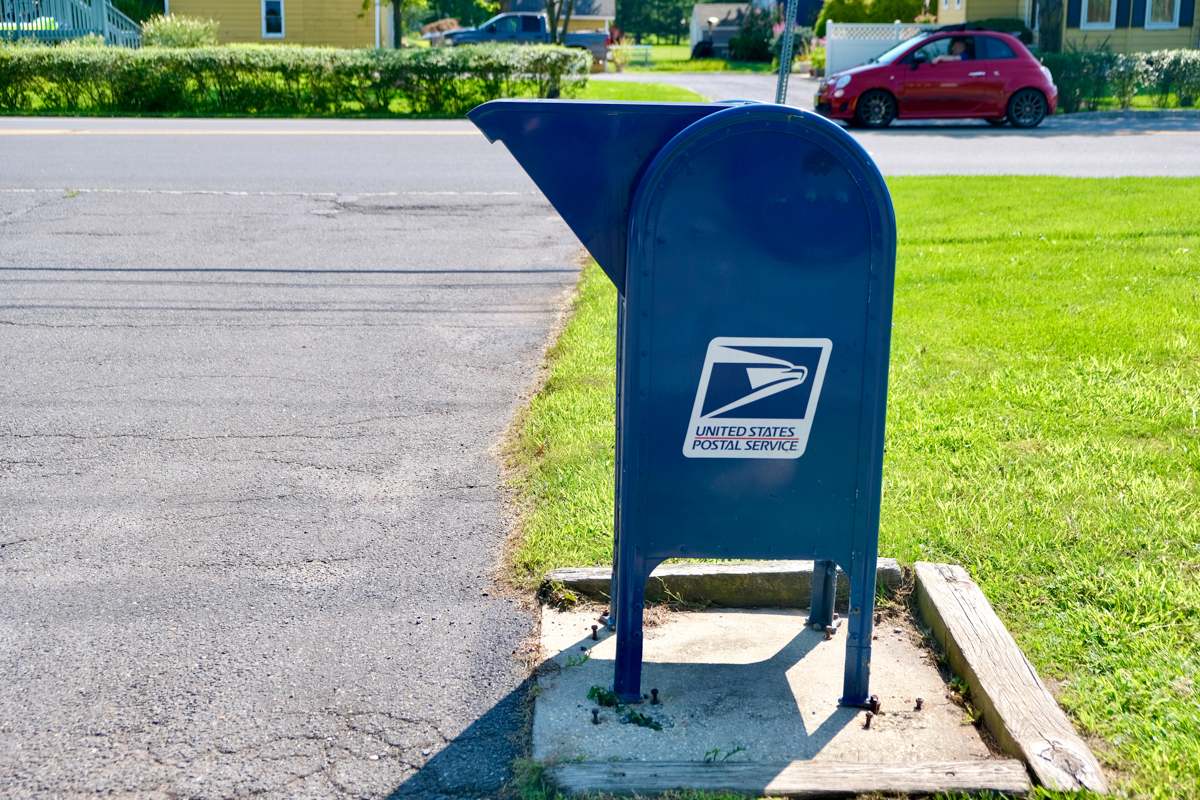 A blue US federal mail box is pictured for drop off mail in a South Florida Neighborhood. Federal Mail Fraud Charges are serious in Florida according to a Federal Atttorney