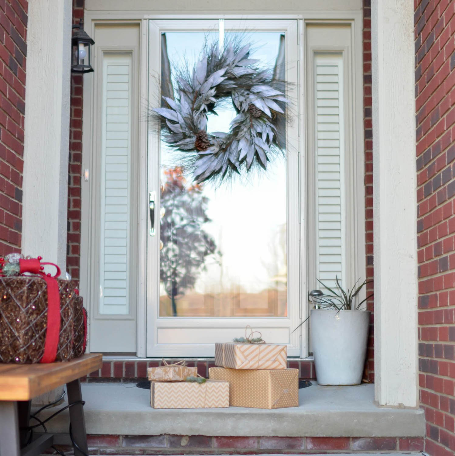 Holiday Package Theft is on the rise in South Florida - this image shows a door at a Fort Lauderdale home decorated for the holidays with packages and gifts on the doorstep