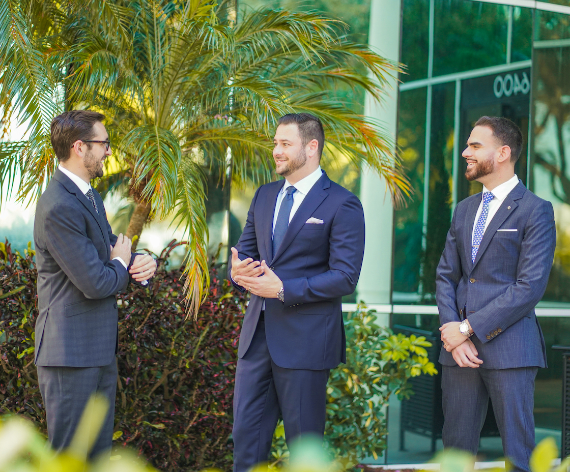Rossen Law Firm Attorneys Manny, Adam and David stand outside the Fort Lauderdale baker and marchman act law office