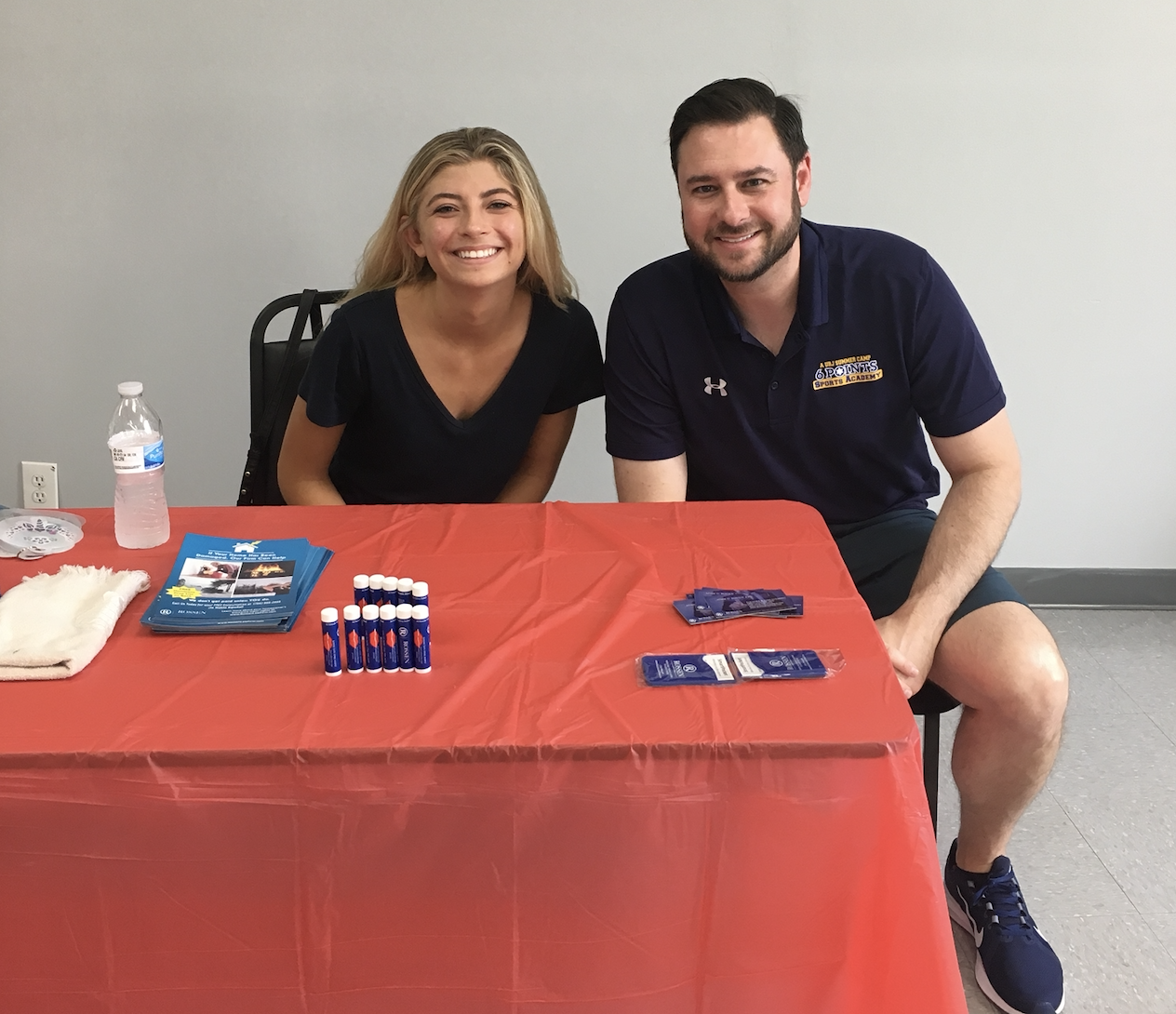Criminal lawyer adam rossen with marketing assistant Olivia at a community event in coconut creek, florida