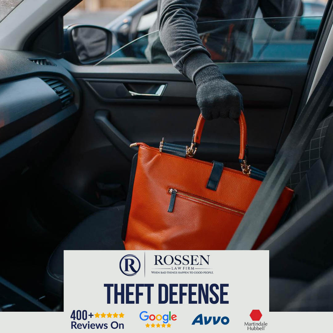 Theft charges have serious consequences in South Florida - oin this image, a man in black with gloves on is stealing a purse from a car through the passenger side window in Fort Lauderdale