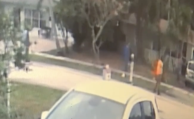 surveillance footage image shows people trespassing onto a mans yard in Pompano Beach, Fllorida