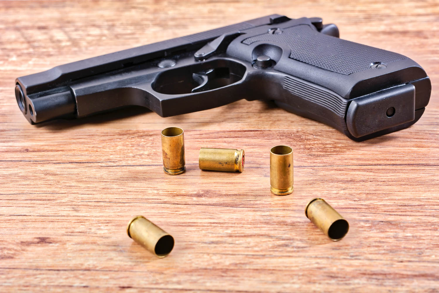 A hand gun and some bullets and ammunition sit on a table in a South Florida Home