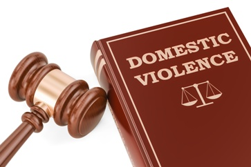 Domestic Violence Book With Scales of Justice and a Gavel