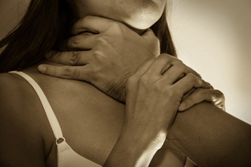 A Man With Hands on a Woman's Neck Causing Strangulation
