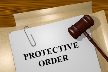 Protective Order Paperwork With a Gavel