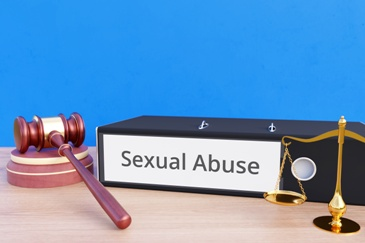 Sexual Abuse Law Book With Gavel and Scales of Justice