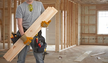 Carpenter Working on a New House Construction