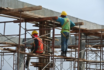 Two Construction Workers Working on a New Site