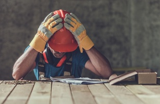 Worried Construction Worker After Being Injured