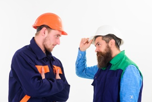 Two Construction Workers That Are Irritated With Each other Hofmann & Schweitzer