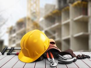 Construction worker helmet and tools on dangerous job site