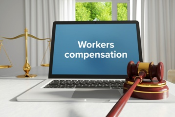 Workers' Compensation Computer Screen With Gavel and Scales of Justice