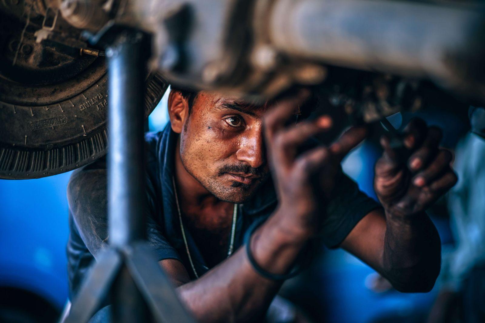 mechanic maintaining car
