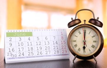 Desk Calendar With a Clock