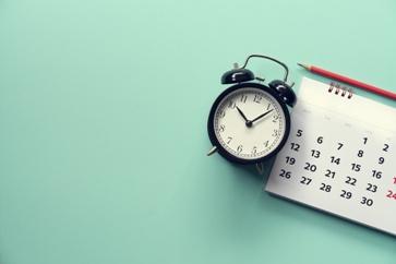 Clock and Calendar on a Desk