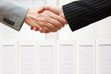 A Client and Lawyer Shaking Hands at the Start of a SSDI Case