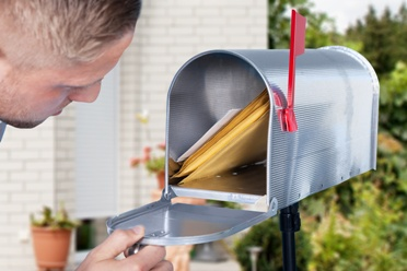 Man Checking Mailbox for an SSDI Check