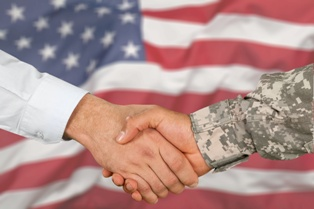 Veteran Shaking the Hand of a Lawyer in Front of an American flag