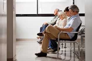 Numerous People in a Waiting Room Looking for Public Assistance