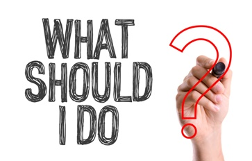 Hand Writing a What Should I Do Sign