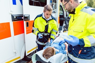 Young Child on a Stretcher After a Car Accident