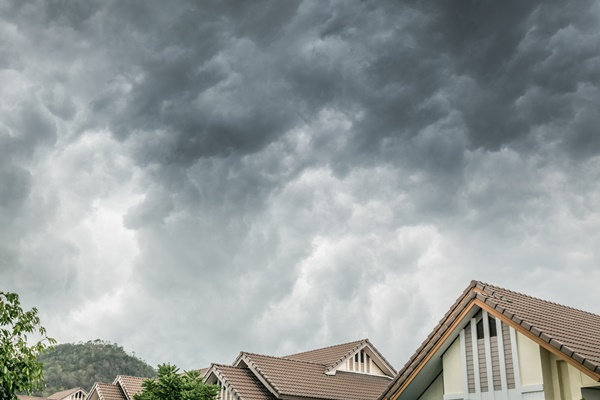 Dark cloud hanging over a house