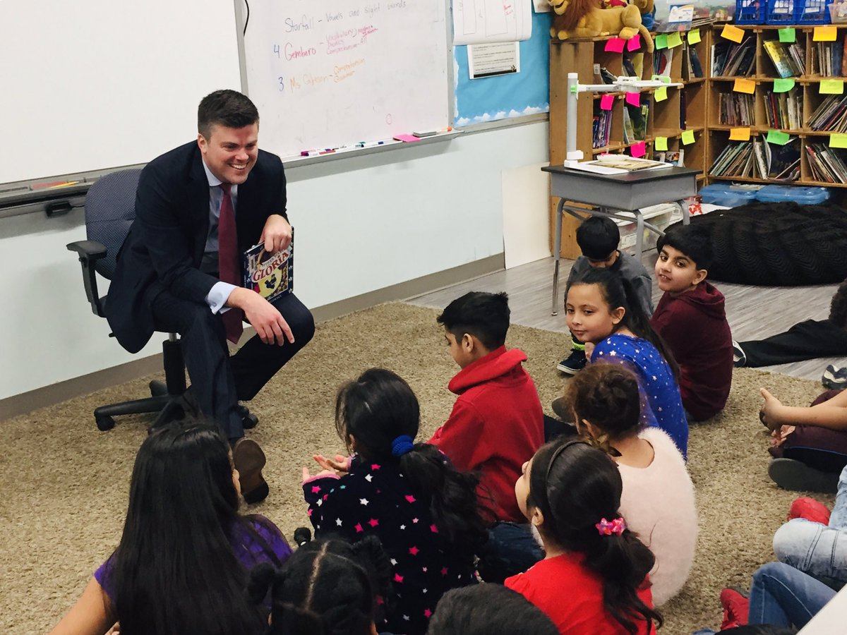 Real man, Attorney Kevin McManus, reading to children for Read Men Read event at the Hickman Mills School District