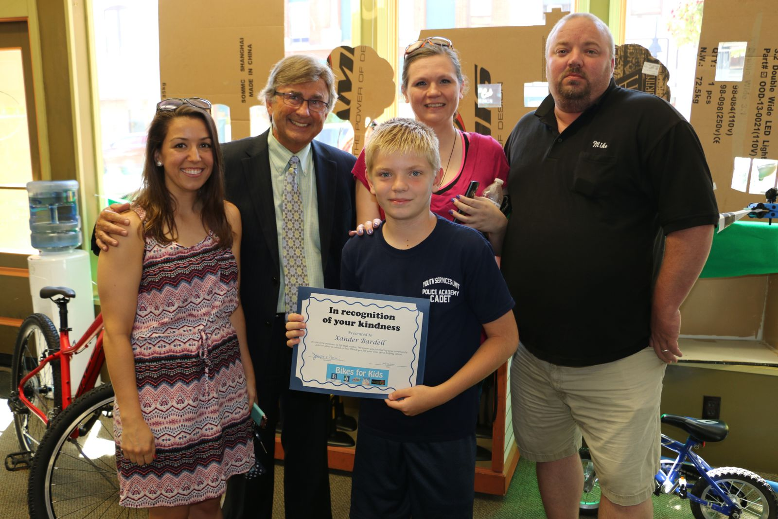 Rachel Jaksa, Joe Barberi, Xander Bardell, and family - Bikes for Kids winner 2016