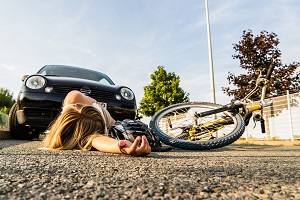Young bicyclist struck by auto