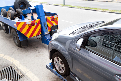 Car totaled in a South Florida Car Accident is getting towed away from the scene of the car crash on 595 and 95. Florida Car Accident Lawyer Rosenberg Law Firm explains what to do after your car was totaled.