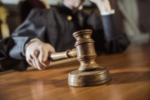 blurred image of judge hitting gavel in courtroom