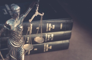 scales of justice next to stack of law books