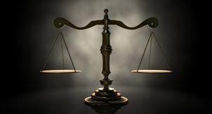scales of justice with dark background