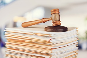 stack of files with gavel on top