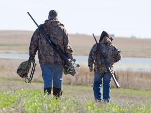 father and son with hunting equipment