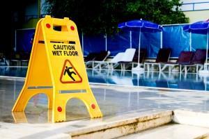 Caution Wet Floor Sign on pool deck