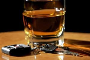 keys and shot glass of whiskey