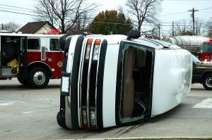 white van on side after accident