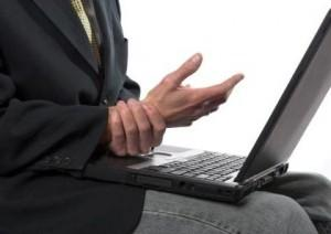 man with laptop and wrist pain