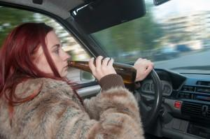 woman drinking while driving