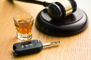 key, drink and a gavel