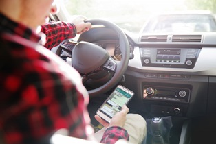texting and distracted driver in GA Van Sant Law