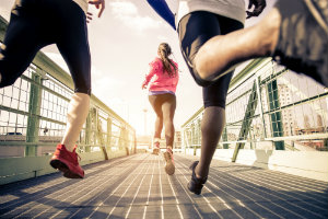 Runners on a bridge